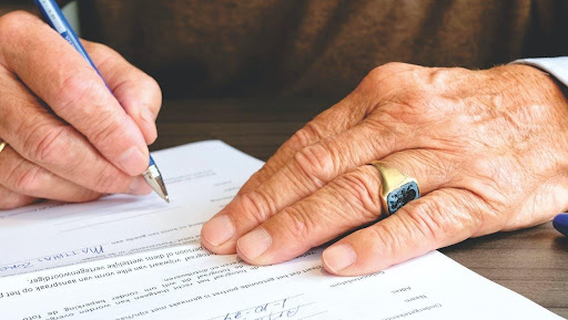 Hands-Old-Person-Signing-Document